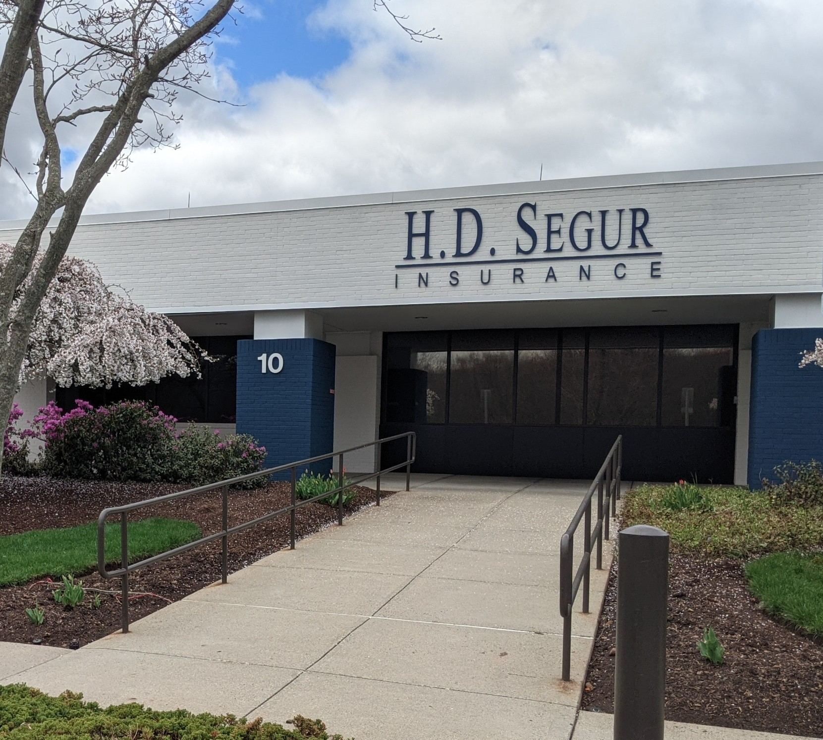 HD SEGUR signage infront of office